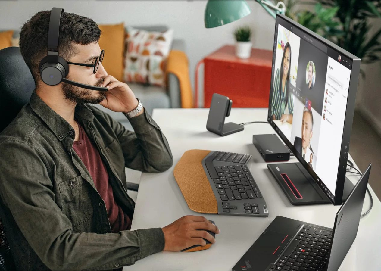 Man using Lenovo Go accessories in a home office setting
